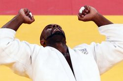 1041888_france-s-teddy-riner-celebrates-winning-his-men-s-100kg-gold-medal-judo-match-aginst-russia-s-alexander-mikhaylin-at-the-london-2012-olympic-games