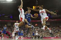 1049064_france-s-dumerc-goes-in-for-a-lay-up-between-taurasi-and-mccoughtry-both-of-the-u-s-during-their-women-s-gold-medal-basketball-match-at-the-north-greenwich-arena-during-the-london-2012-olympic